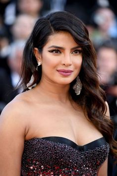 """Priyanka Chopra Jonas wore a Roberto Cavalli Couture black strapless gown with an embroidered dégrade effect to the 2019 Cannes Film Festival premiere of """"Rocketman"""". She's also wearing Chopard jewels (III) Indian Bollywood Actress, Bollywood Actress Hot Photos, Indian Actress Hot Pics, Bollywood Girls, Beautiful Bollywood Actress, Most Beautiful Indian Actress, Beautiful Actresses, Bollywood Bikini, Hot Actresses"""