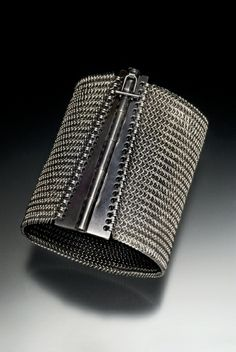 Bracelet | Rebeca Mojica. More than 4,000 stainless steel jump rings were linked to make this three-inch wide cuff