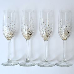 Whether you're throwing a swank holiday soiree or looking for unique gifts for your friends, these chic DIY gold dot champagne flutes are sure to awe!