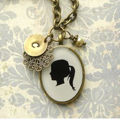 cute idea!-Personalized Silhouette Brass Oval Necklace with Initial Charm and Pearl Dangle for Mother or Grandmother. $69.50, via Etsy.