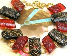 "1800s BUTTON  bracelet, Victorian cranberry & black glass on gold. 7.5"" bracelet. Antique button jewellery. - pinned by pin4etsy.com"