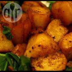 Preheat oven to Gas 7. Put potatoes in a microwavable dish add splash of water, cover. Cook for about 9 minutes (900 watts). Put on tray. Spray with oil, and sprinkle on the OXO cubes.  Roast in the oven