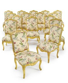 A SET OF TWELVE LOUIS XV CARVED GILTWOOD CHAIRS CIRCA 1735 Together with eight later copies. 20 pieces.