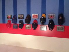 Displaying team pictures & old baseball hats