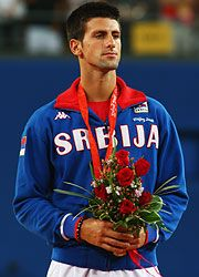 Novak Djokovic is flag bearer for Serbia during London Olympics.