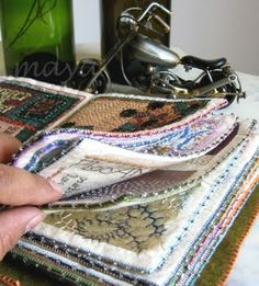 Fiber book --tutorial -- This would be a great way to put all the stitches on my sewing machine. I could see them stitched out