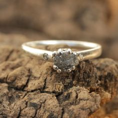 Stelring silver band with prong set rough diamond and twin side set traditional diamonds