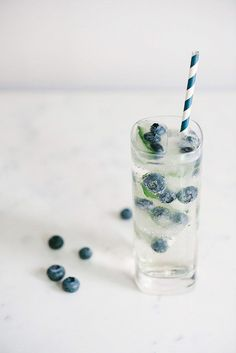 Blueberry Vodka: mint leaves in the bottom of your shaker and muddle. Add regular ice (not the fancy fruit ice), 1 oz Smirnoff Blueberry Vodka, 2 oz Club soda. Add St Germain for a touch of sweetness. Party Drinks, Fun Drinks, Yummy Drinks, Alcoholic Drinks, Beverages, Colorful Drinks, Refreshing Drinks, Smirnoff, Summer Cocktails