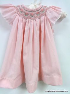 $18 forsize 2 pink microcheck bishop smocked with watermelons. Angel sleeves are edged with baby heirloom lace. I did not make this--it was a gift. But it is well made and in good condition.