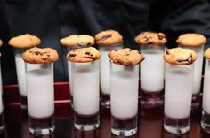 I'm going to ask our caterer to do cookies and milk at the end of the evening...I've worked wedding where he did it and I love it :-) Heck, cookies instead of cupcakes? Im not doing cake at all...
