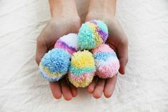 Adorable tutorial: How to Make Easy Easter Egg Pom-Poms - Tuts+ Crafts & DIY… Easter Projects, Easter Crafts For Kids, Yarn Projects, Easter Gift, Crafts For Teens, Crochet Projects, Gifts For Kids, Crochet Ideas, Pom Pom Crafts