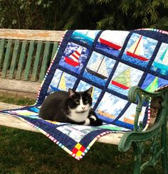 Paper-pieced sailboat quilt with Alex, the cat.