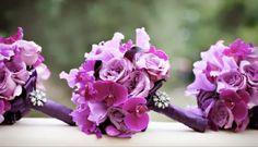 Pantone color of the year 2014 is Radiant Orchid.  These bouquets are the perfect color.