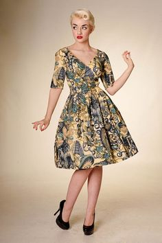 Ohhhh. Day dresses with elbow-length sleeves.