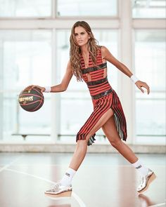 Posing with a basketball, Izabel Goulart wears striped dress with platform shoes for Glamour Brazil Magazine August 2016 issue
