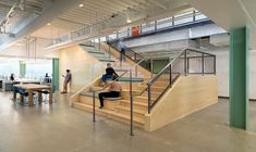 Evernote Offices Designed With Creative Details in interior design- extra wide stairs with cushions on the left for break time seating