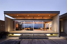 'Crosson Clarke Carnachan Architects is the Auckland based architectural firm that designed this awesome house in Omaha Beach in 2007. The part that I like most about this house is the expansive views out over the water and the large deck.'