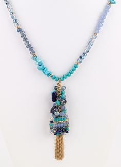 Turquoise and blue hues beaded long necklace with tassel pendant