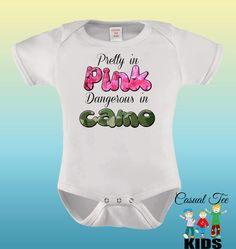 Pretty in Pink Dangerous in Camo Baby Girl Hunting Baby Bodysuit or Toddler Tee    Each bodysuit is custom made to order. This bodysuit is