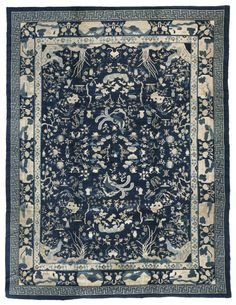 Antique Chinese Oriental Rugs employ a palette of blue, beige, apricot and yellow as their main colors. They display motifs that include the classical Buddhist or Taoist symbols of longevity, elaborate lotus blossoms, chrysanthemums, cloud band motifs, dogs and birds. They are usually framed with a simple, wide border. In contrast to these earlier Chinese antique rugs, twentieth century Chinese Art Deco rugs can be in spare in design and quite radical in color.