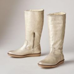 GOLDEN SHEARLING BOOTS--Trust Trask™ to add a touch of luxury to a super-comfy, shearling lined boot. Distressed metallic Italian suede boasts silver leather lacing at the topline. Partial inside zipper. Imported. Whole and half sizes 6 to 10, 11.