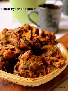 palak pyaaz ke pakode - crispy spinach onion fritters! Easy recipe and a quick video too!