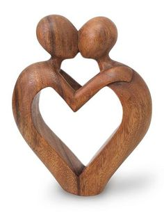Wood sculpture, 'Sweet Love'. Shop from #UNICEFMarket and help save the lives of children around the world.