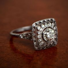 WOW! A lovely floral motif vintage style engagement ring. Handcrafted by Estate Diamond Jewelry.