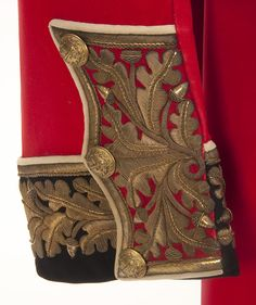 THE GENERAL A.W. THORNEYCROFT UNIFORM GROUPING. British Victorian identified General's uniform group. Formerly the property of General A. W. Thorneycroft, a hero of the Boer War. Red wool frock coat with black collar and cuffs piped white. Both cuffs and collar are heavily embroidered in a gold bullion oak leaf motif. Has brass General's pattern buttons. Complete with gold cord shoulder boards with rank insignia. Interior with padded silk lining with tailor's label named to Gen…