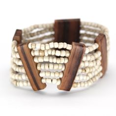 ANTIK BRACELET Multiple strands of glass beads on stretch cord with sustainable indian rosewood accents. Handmade by talented artisans in developing countries. Fair trade. Imported.