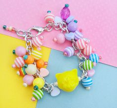 Click and save 10 percent now with coupon code CUTIE10. Fairy Kei Lisa Frank Bracelet  Kawaii Kitten by FrostedSoSweet