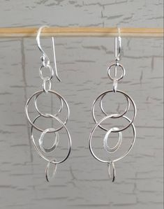 Dangling circle earrings in sterling silver Circle Earrings, Dangle Earrings, 925 Silver, Sterling Silver, Silver Horse, Infinity Pendant, Circles, Dangles, My Etsy Shop