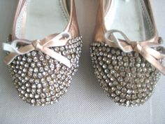 Pink Pazzion ballet flats with rhinestones.