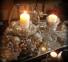 Candles are always a grew centerpiece but the silver accents glittering around them just put this over the top. We will be re-creating this New Year's Eve for our own dining room table.