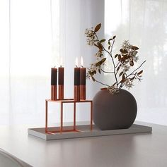 @catcooee lighting the candles in her Kubus 4 in copper.  #bylassen #kubus #bylassenkubus #mogenslassen