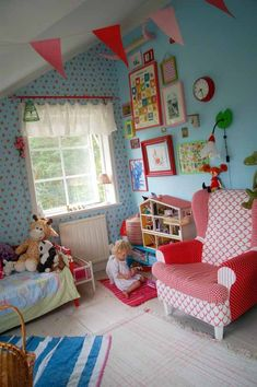 blue walls and bright reds; kids' room; great color scheme for a shared boy/girl room. this is just so FUN! bunting, red curtain rod; red frames and funky upholstered chair Toy room ideas!