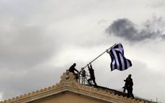 Yannis Behrakis—Reuters April Greek parliament employees raise a mast after they replaced a torn-off Greek flag with a new one atop the parliament in Athens Syntagma (Constitution) square. Invention Of Photography, Greek Flag, Bail Out, Hans Christian, Latest News Headlines, Pictures Of The Week, News India, Elizabeth Ii, Photojournalism