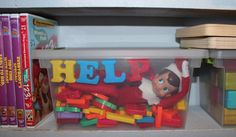 """Our first day with our little elf, and somehow he got stuck in a container of magnetic letters.... So glad he knows how to spell. :)"""
