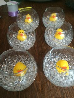 For centerpieces, we put rubber ducks in cheap cases from the dollar store and added aqua gems to look like rubber ducks in a bubble bath