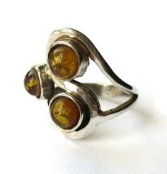 Vintage Baltic amber ring, sterling silver freeform squiggle ring, 3 amber cabochons, modernist design, vintage ring, swirls and loops. https://www.etsy.com/uk/listing/458417402/vintage-baltic-amber-ring-sterling