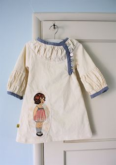 nice blend of vintage and modern styling - the applique pocket is nice, although I think a smaller figure would be more in proportion