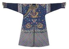 A formal court robe (chifu) of blue silk. Qing dynasty, circa 1870-1880 . Photo 2911 Christie's Ltd.  Embroidered with a blue fretwork ground, with nine gilt dragons, the lower sleeves with blue bands.
