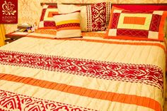Double bed quilt set with Rilli hand-work detailing.