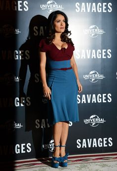 Salma Hayek in a hard working push up bra and tight dress