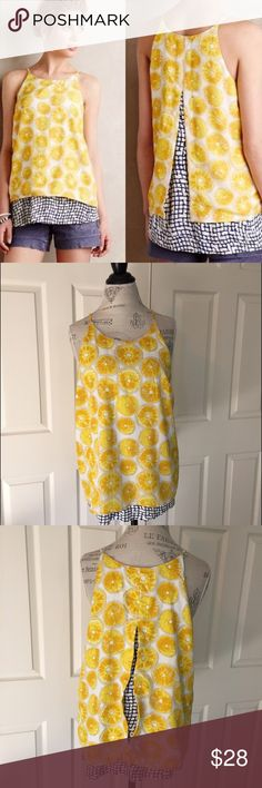 "Anthropologie Porridge Lemon Print Swing Top so cute and hard to find! lemon print layered swing style top with split back detail from Porridge for Anthropologie. body is 100% poly with the underlayer 100% knit viscose. this is a re-posh as it sadly did not fit me. very good condition but please see close-up for discoloration under armpits (from denim jacket I believe) and a couple tiny .25"" area with snags. size large. bust flat is 20"". length is 26.5"". Anthropologie Tops"