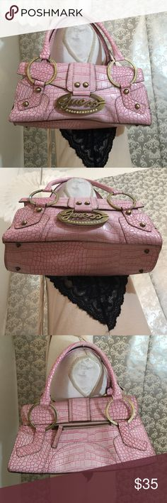 Guess pink/rhinestones alligator print handbag Like new 12 inches in width 6 inches in height has pocket zipper on backside two extra pockets inside Guess Bags
