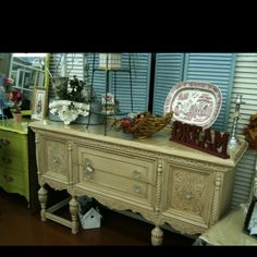 Antique buffet, when I first got this it was metallic silver! I re-painted it and put new knobs on!!