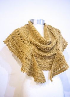 A large, warm shawl knit in DK weight lambswool yarn. The body of the shawl is completed first, starting with 3 sts and increasing to 309 sts. Next, the lace edging is knit on from side-to-side, no need for sewing!
