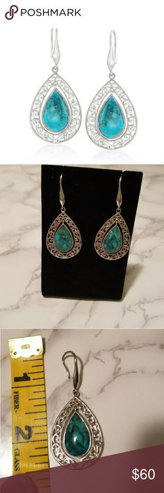 NWOT Turquoise Cabachon Pear Shaped Earrings This is a beautiful pair of pear shaped Cabachon earrings set in Sterling silver scrollwork. They are new without tags. They're so pretty, but a little heavy for my liking. Comes with dust bag shown in last photo. Ross-Simons Jewelry Earrings