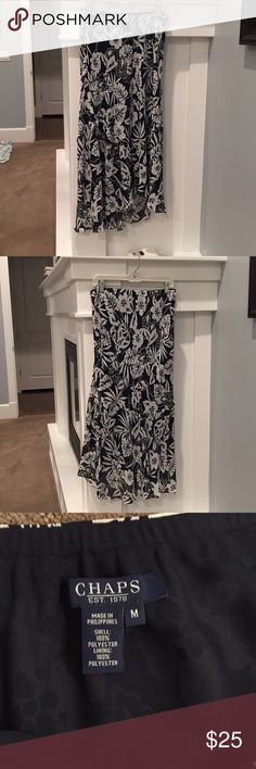 """Chaps high-low ruffle hem floral skirt Chaps label navy blue and white ruffle hem skirt. Hi-low cut with front length measuring about 30"""" and the back about 36"""". Elastic waist measures about 15.5"""". Darling skirt on, just doesn't fit me anymore! Chaps Skirts High Low"""